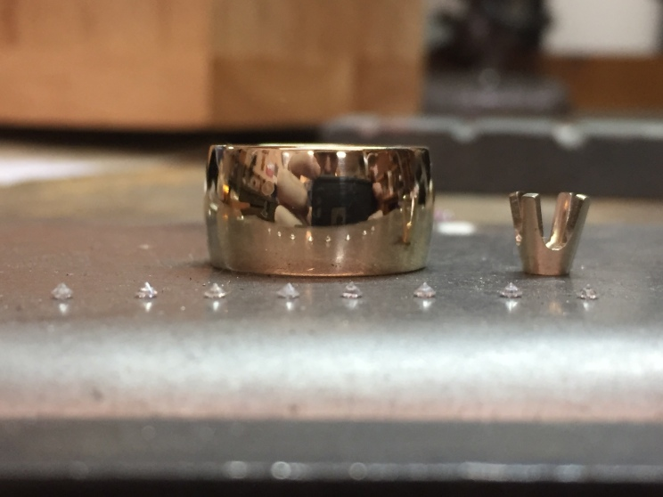 14k gold 10mm band & eight loose 1.5mm round diamonds.