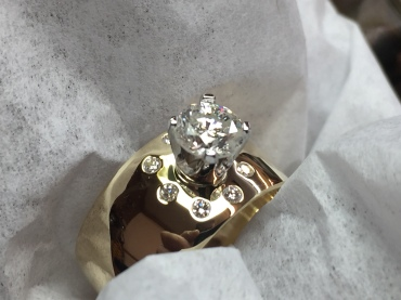 Ring polished and completed. 14k yellow gold, .70ct round brilliant center diamond, 1/5ct flat set accent diamonds. .90ct total diamond weight.